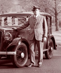 Ian Bayley, Proprietor of Sabrestorm Publishing, with his Austin 12 car.