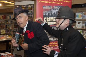 Viv the Spiv almost got away with a copy of Penny Legg's book at the launch of 'Crime in the Second World War'. Luckily PC Joe was on hand!