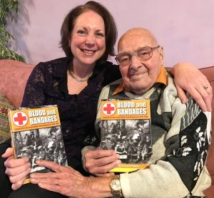 Liz Coward and William Earl with copies of 'Blood and Bandages'